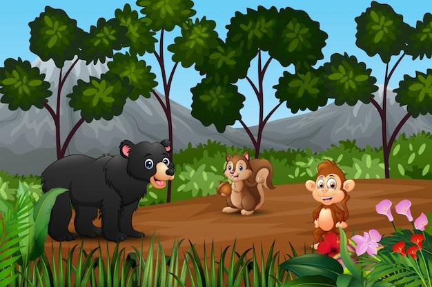 Grupo de animais selvagens se reunindo na orla da floresta