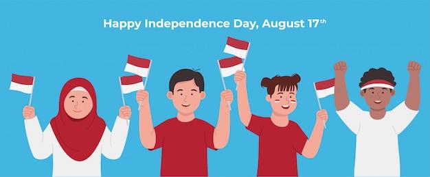 Grupo de crianças felizes comemorando o dia nacional da indonésia