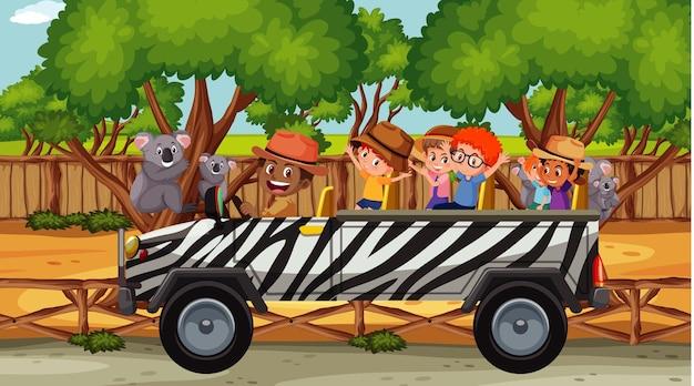Grupo de crianças no zoológico com muitos coalas