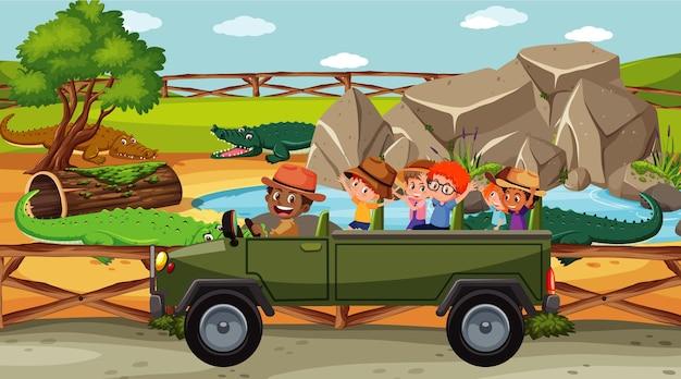 Grupo de crianças no zoológico com muitos crocodilos