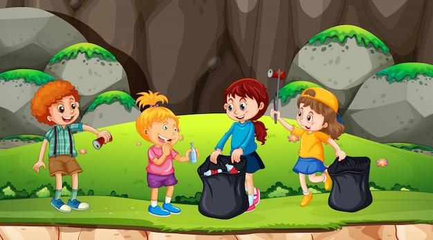 Grupo de crianças pegando lixo