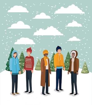 Grupo de homens em snowscape com roupas de inverno