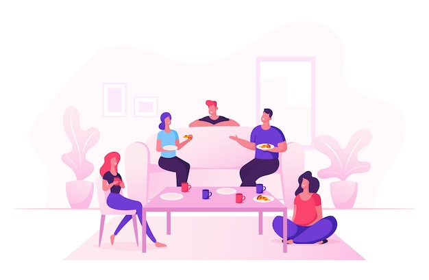 Grupo de jovens comemora festa em casa, sentados à mesa na sala de estar, comendo pizza e bebendo chá