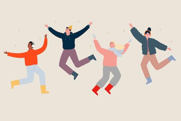 Grupo de jovens vestindo roupas de inverno pulando