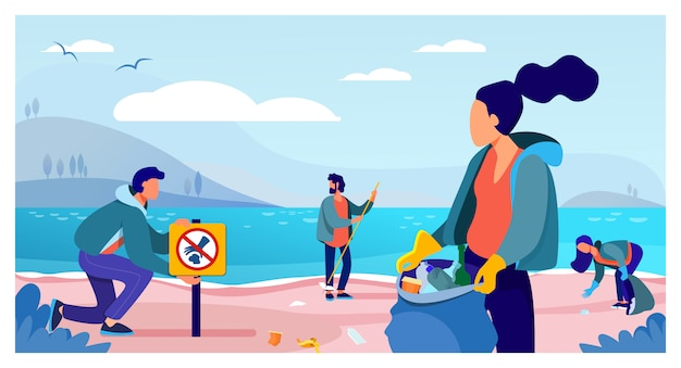 Grupo de jovens voluntários coletando lixo na praia do oceano