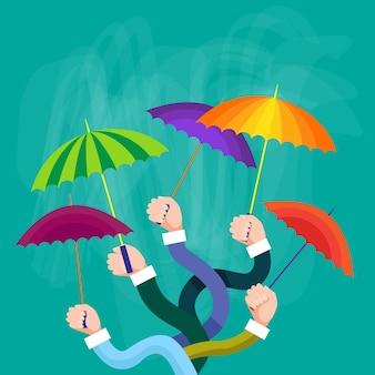Grupo de mãos segurando guarda-chuvas coloridos, conceito de apoio