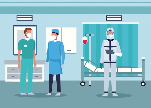 Grupo de médicos usando máscaras médicas no quarto do hospital