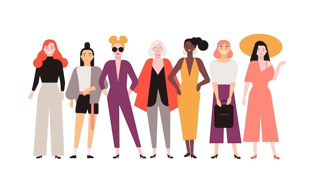 Grupo de mulheres adoráveis vestidas com roupas da moda, isoladas no fundo branco. sorrindo amigas juntas de pé. retrato de garotas elegantes alegres bonitos. ilustração em vetor plana dos desenhos animados.