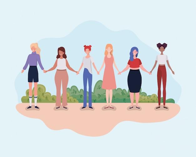 Grupo de mulheres jovens em pé no campo