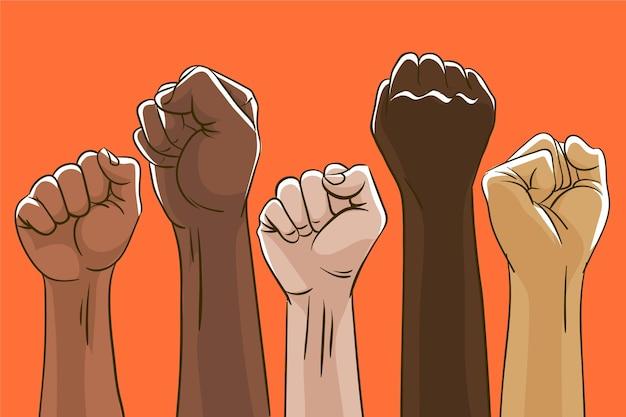 Grupo de multirraciais levantou os punhos juntos