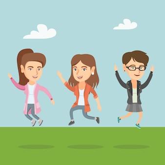 Grupo de pessoas caucasianas alegres pulando.