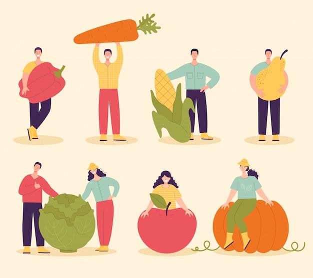 Grupo de pessoas com grandes vegetais e frutas