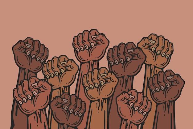 Grupo de pessoas com os punhos erguidos