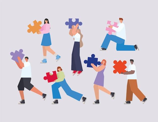 Grupo de pessoas com peças de quebra-cabeça em um fundo cinza