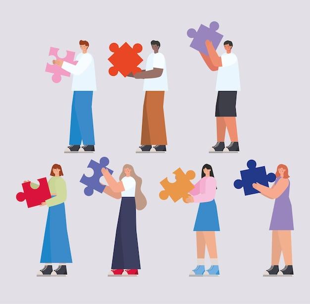 Grupo de pessoas com peças de quebra-cabeça