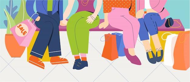 Grupo de pessoas sente-se na loja depois das compras.