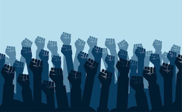 Grupo de punhos erguidos no ar. punhos de grupo de manifestantes levantados