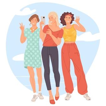 Grupo de três garotas tirando uma selfie e rindo