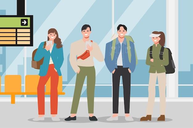 Grupo de turistas com mochilas em pé no aeroporto.