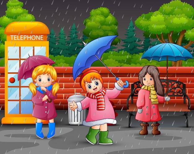 Guarda-chuva de três garota cartoon