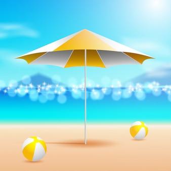 Guarda-chuva e bolas a beira mar