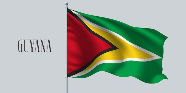 Guiana agitando bandeira no mastro da bandeira