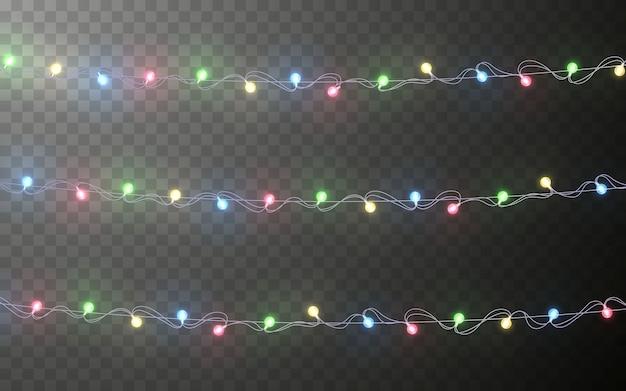 Guirlanda de cores de natal, decorações festivas. decoração de efeito transparente de luzes de natal brilhantes em fundo escuro.