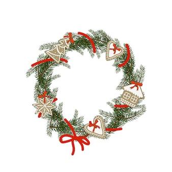 Guirlanda de natal de ramos de abeto com pão de mel em forma de coração, casa, floco de neve. decoração festiva para ano novo e feriados de inverno