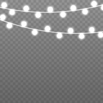 Guirlanda de natal isolada em um fundo transparente com luzes brilhantes para cartões de natal