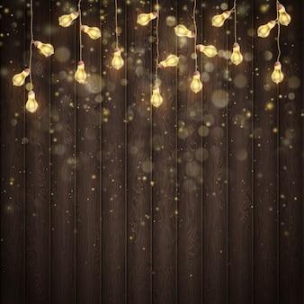 Guirlanda de natal luzes sobre fundo rústico marrom de madeira. e também inclui