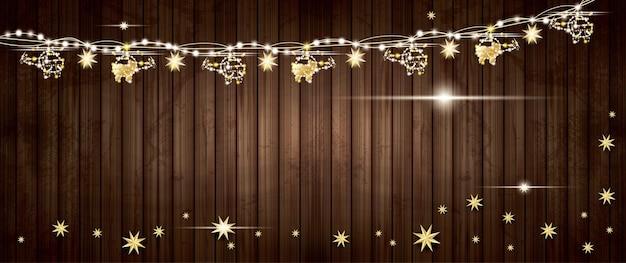 Guirlanda de ouro com helicópteros e estrelas na textura de madeira