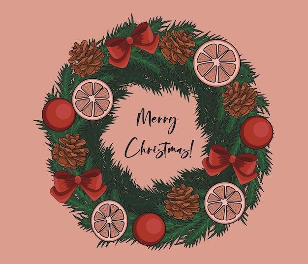 Guirlanda festiva de natal com rodelas de laranja e pinhas