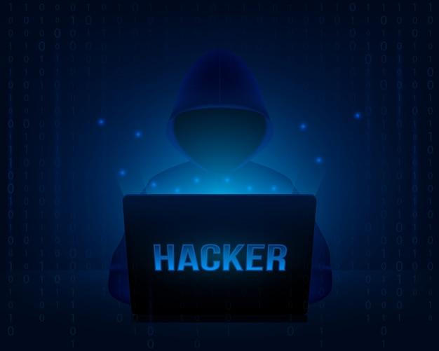 Hacker com capuz em um laptop.