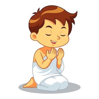 Hajj menino muçulmano rezando