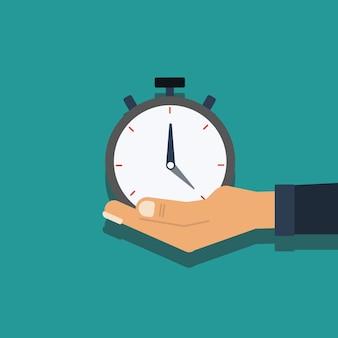 Hand hold cronômetro para o conceito de tempo de gestão