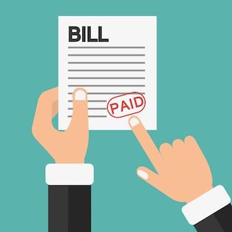 Hand holding bill