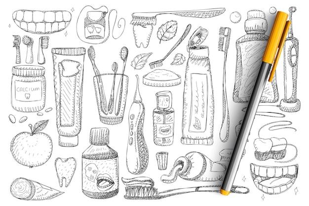 Higiene dental e saúde doodle conjunto. coleção de escova de dentes desenhada à mão, pasta de dentes, fio dental, dentes e sorriso branco isolado.