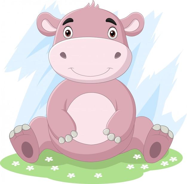 Hipopótamo bebê fofo dos desenhos animados, sentado na grama