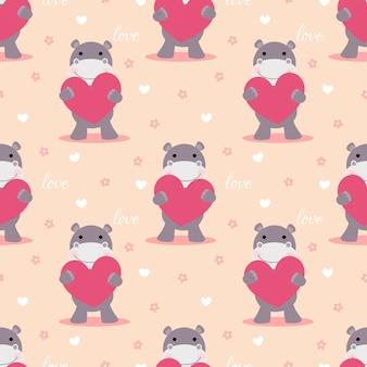 Hipopótamo fofo segurar um padrão sem emenda de coração rosa.