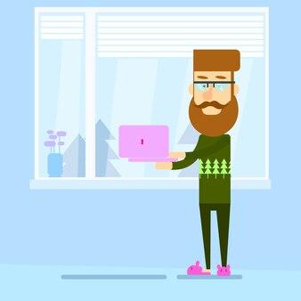 Hipster homem segurando laptop carrinho perto de janela