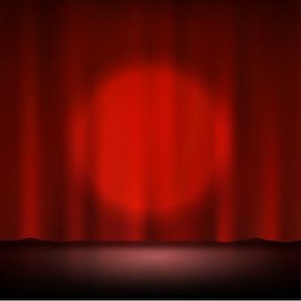 Holofote no palco vermelho cortina