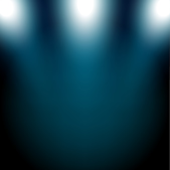 Holofotes azuis brilhando no fundo escuro