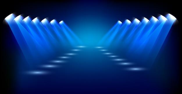 Holofotes azuis em fundo escuro