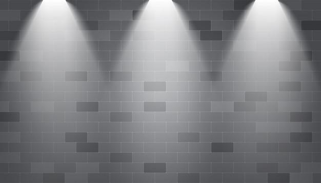 Holofotes de fundo iluminado em uma parede de tijolos