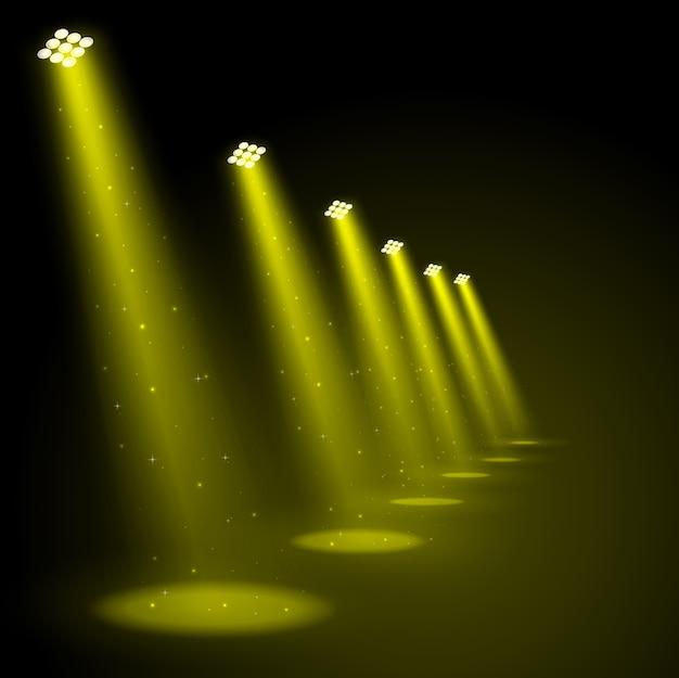Holofotes de ouro brilhando fundo