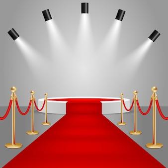 Holofotes e pódio de palco com tapete vermelho