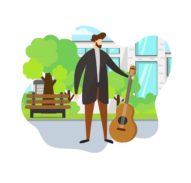 Homem à moda que mantém a guitarra acústica disponivel. parque.