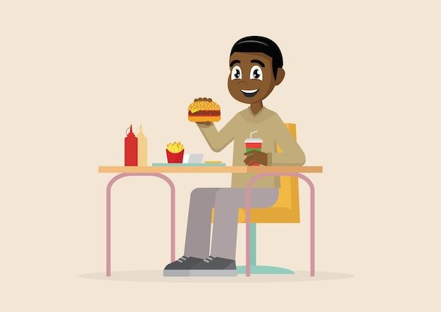 Homem africano, comendo fast-food