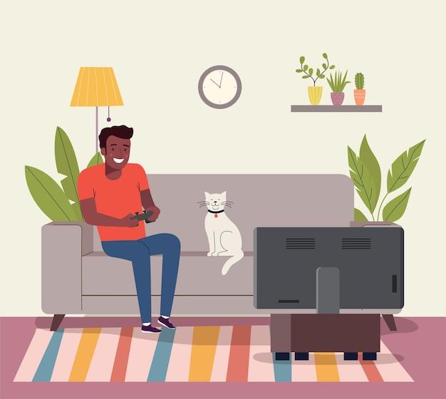 Homem afro-americano jogando videogame no sofá.