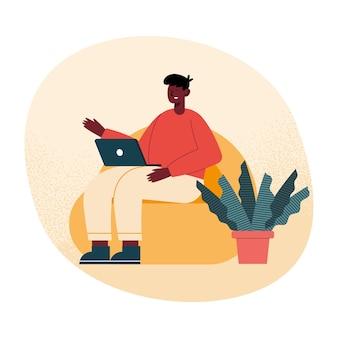 Homem afro com laptop na sala de estar